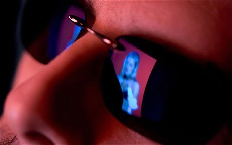 Reflection in sunglasses of porn viewer